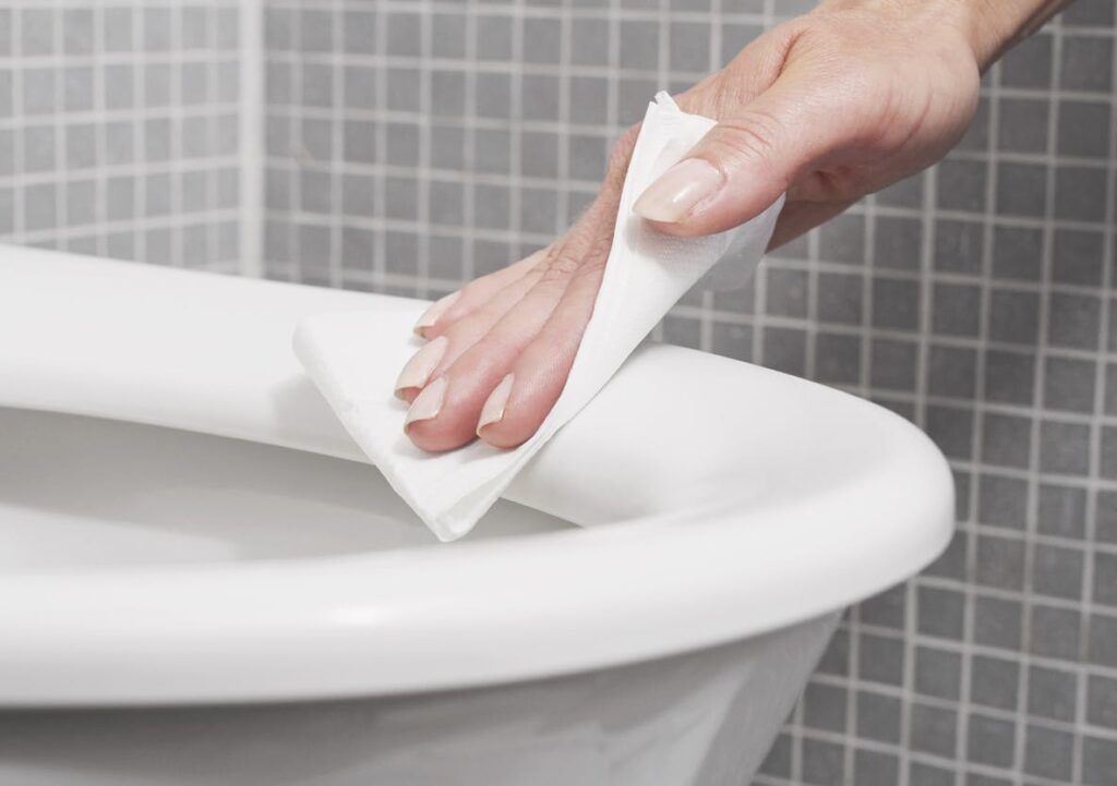 wiping COVID toilet plume off toilet seat